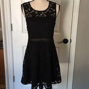 Sleeveless black dress by Garage size L/G